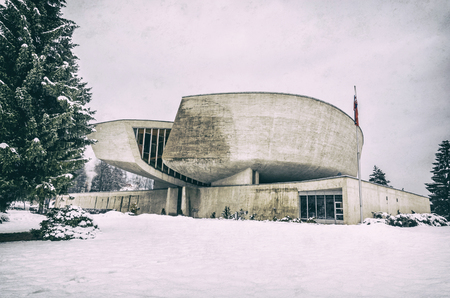 SNP Museum in Banska Bystrica, Slovak republic. Architectural theme. Travel destination. Analog photo filter with scratches.