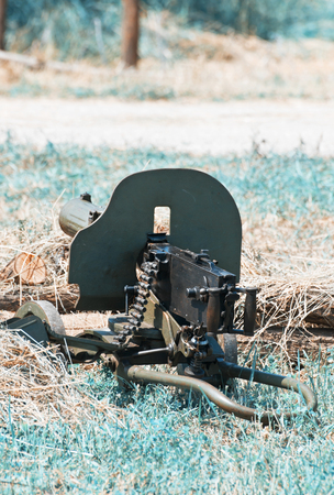 Green german machine gun of World War II. Ready to fire. Teal and orange photo filter.