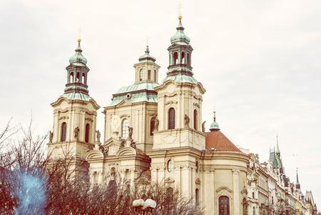 St. Nicholas church at Old Town Square, Prague, Czech republic. Architectural theme. Travel destination. Retro photo filter.