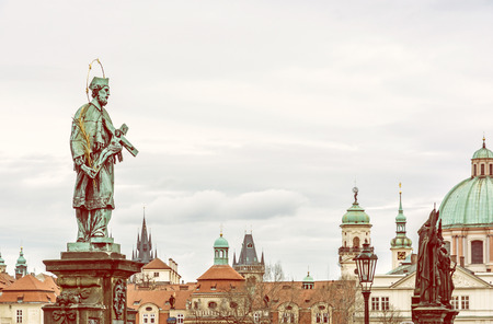 St. John Of Nepomuk Statue on Charles Bridge in Prague, Czech republic. Travel destination. Cultural heritage. Yellow photo filter. Stock Photo