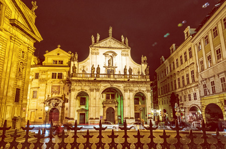 Saint Salvator church in Prague, Czech republic. Architectural scene. Travel destination. Night scene. Yellow photo filter.