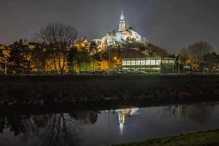 Ancient castle is mirrored in river, Nitra, Slovak republic. Night scene. Cultural heritage. Architectural theme.