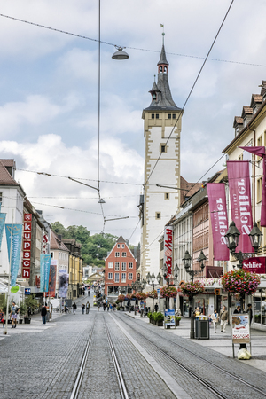 WURZBURG, GERMANY – JULY 14, 2019: Ratskeller, Wurzburg, Bavaria, Germany. Illustrative editorial. Travel destination. Street scene with tourists.