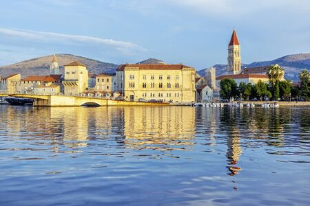Old town Trogir is mirroring in sea, Croatia, Europe. Sunrise time. Summer vacation.