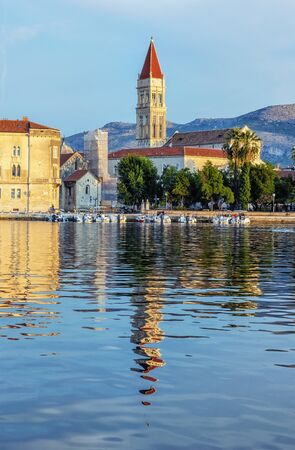 Trogir cathedral is mirroring in sea, Croatia, Europe. Sunrise time. Summer vacation.