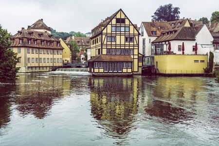Traditional buildings and Regnitz river in Bamberg, Bavaria, Germany. Travel destination. Architectural theme. Banco de Imagens