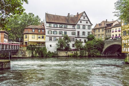 Traditional buildings and Regnitz river in Bamberg, Bavaria, Germany. Travel destination. Architectural theme. Stock Photo