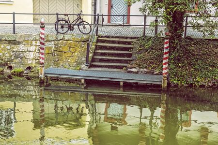Retro bicycle is reflected in the river, Bamberg, Bavaria, Germany. Travel destination.