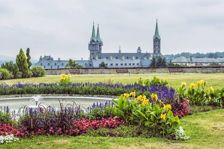 Cathedral and flowering garden from Michaelsberg abbey in Bamberg, Bavaria, Germany. Travel destination. Religious architecture. Stock Photo