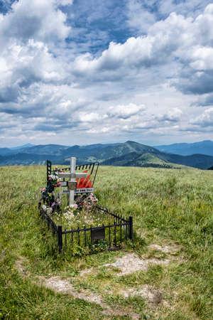 Symbolic grave of the Slovak National Uprising, Ploska peak, Slovak republic. Seasonal natural scene. Travel destination. Hiking theme.