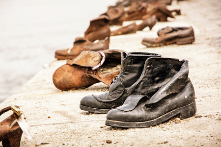 Shoes monument on the Danube bank is a memorial in Budapest Hungary Retro photo filter Symbolic artistic object Editorial
