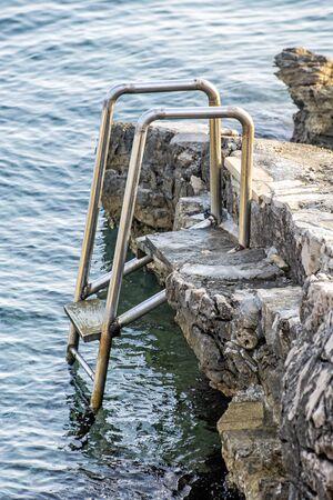 Metallic ladder on the beach, Solta, Croatia. Summer vacation. Stockfoto