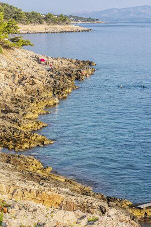 Stoned beach, Solta, Croatia Summer vacation. Travel destination.