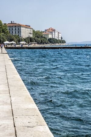 ZADAR, CROATIA – AUGUST 22, 2019: Many tourists are walking and relaxing on the pier, Zadar, Croatia, Europe. Summer vacation. Travel destination. Illustrative editorial. Redactioneel