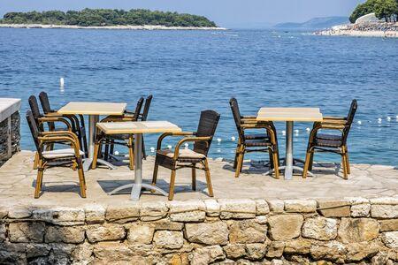 Outdoor restaurant in Primosten town, Croatia. Travel destination. Summer vacation.