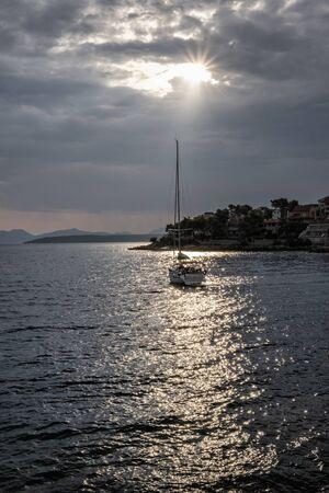 Yacht in Stomorska, Solta island, Croatia. Travel destination. Summer vacation.