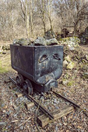 Old mining cart, Somoska, Siatorska Bukovina, Slovak republic. Symbol of miners. Travel destination.