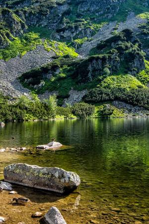 Rohac tarn, Western Tatras, Slovak republic. Hiking theme. Seasonal natural scene.