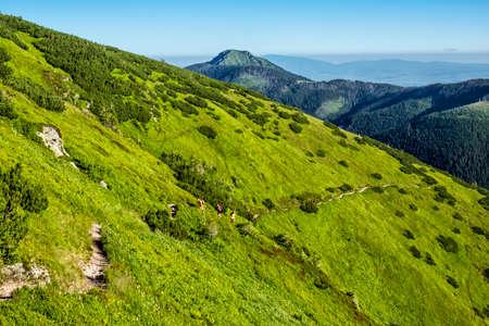Tourist trail in Western Tatras scenery, Slovak republic. Hiking theme. Seasonal natural scene.