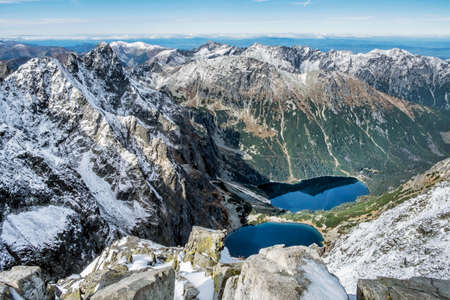 Czarny Staw and Morskie Oko tarn from Rysy peak, High Tatras mountains, Poland. Hiking theme. Seasonal natural scene. Stock Photo