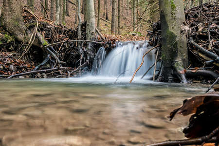 Water stream in forest, Little Fatra, mountains, Slovak republic. Hiking theme. Seasonal natural scene.