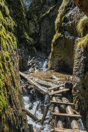 Big waterfall in Velky Sokol gorge, Slovak Paradise national park. Seasonal natural scene.