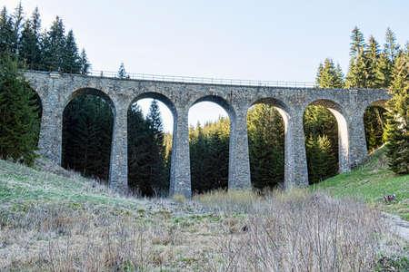 Chmarossky viaduct on one of the most beautiful railway lines in Slovakia Cervena Skala - Margecany. Standard-Bild