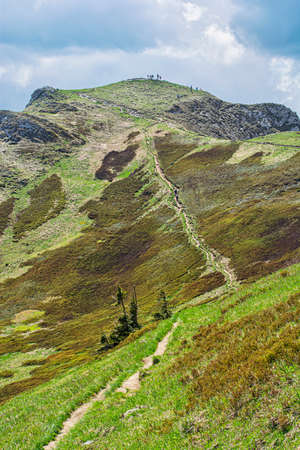 Tourist people on the Chleb hill, Little Fatra, Slovak republic. Hiking theme. Seasonal natural scene.