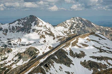 Placlivo and Ostry Rohac peaks from Baranec peak, Western Tatras, Slovak republic. Hiking theme. Seasonal natural scene.