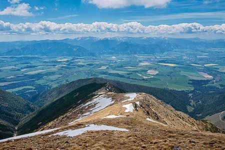 Low Tatras and Liptov basin from Baranec peak, Western Tatras, Slovak republic. Hiking theme. Seasonal natural scene. Standard-Bild