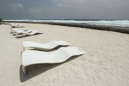 sunbeds: original sunbeds on the beach in maldives resort