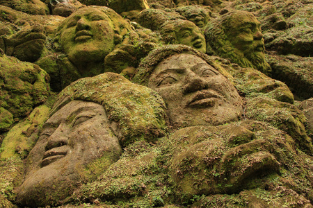 Green Moss covered stone sculptures Stock Photo