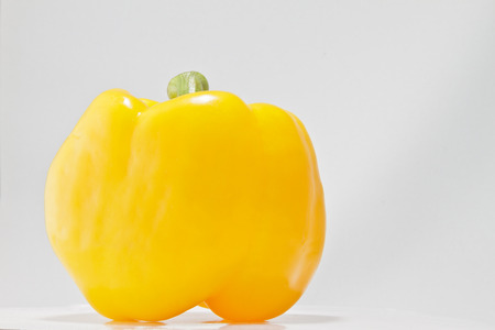 Yellow Bell Pepper on a Light Background