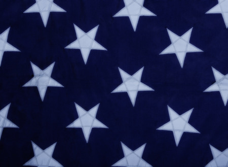 navy blue background: White stars on a blue background.  Close up of the old U.S. Navy Jack