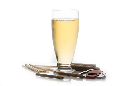 glass cutter: Glass of beer surrounded by cuban cigars matches and cigar cutter Stock Photo