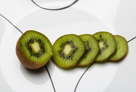 actinidia deliciosa: Sliced Kiwifruit on a white plate