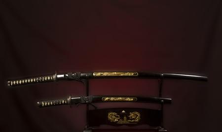ninja tool: Japanese katana swords  on dark background with red spotlight Stock Photo