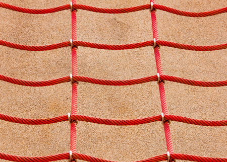 wire netting: Red wire netting on concrete background