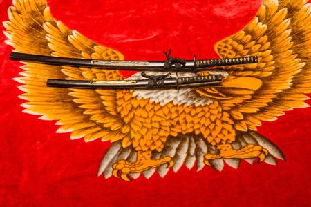 velvety: Japanese Daisho, the Katana and wakisaxhi, against a velvety eagle background