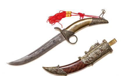 Ornate ceremonial curved dagger and decorative scabbard Stok Fotoğraf - 69782032