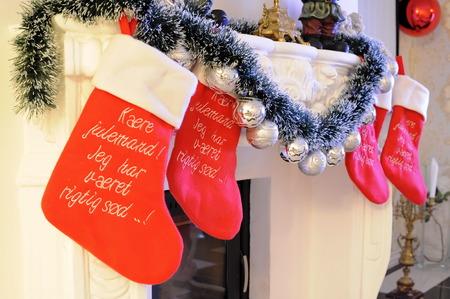 stuffer: Christmas socks at a fireplace Stock Photo