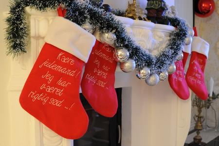Christmas socks at a fireplace Stock Photo