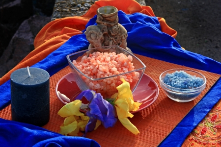 salt lamp: the salt sea on the beach,red and blue, sea salt with candles and aroma lamp   Stock Photo