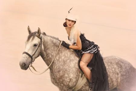 girl dressed as Amazons and horseback    photo