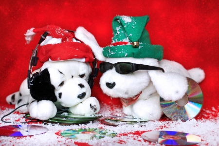christmas music: two toy dogs listen to music on a red background  Stock Photo