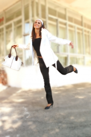 girl with black hair in a white coat with a woman s bag   photo