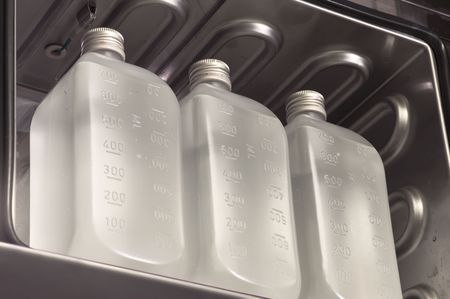 parenteral: Infusion bottles in a stove Stock Photo