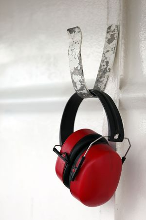 A pair of earmuffs hanging from a hook. photo