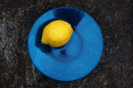 heartiness: A lemon on a blue plate.