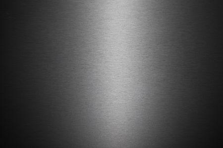A background texture image of a sheet of brushed metal. photo